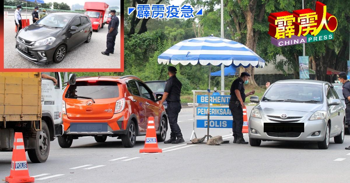 怡保警方在拿乞路设双向路障,不论市民欲进入怡保市区或前往华都牙也,都需要合法文件才能通关。